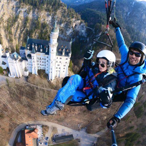 tandem paragliding gopro selfie über schloss neuschwanstein.